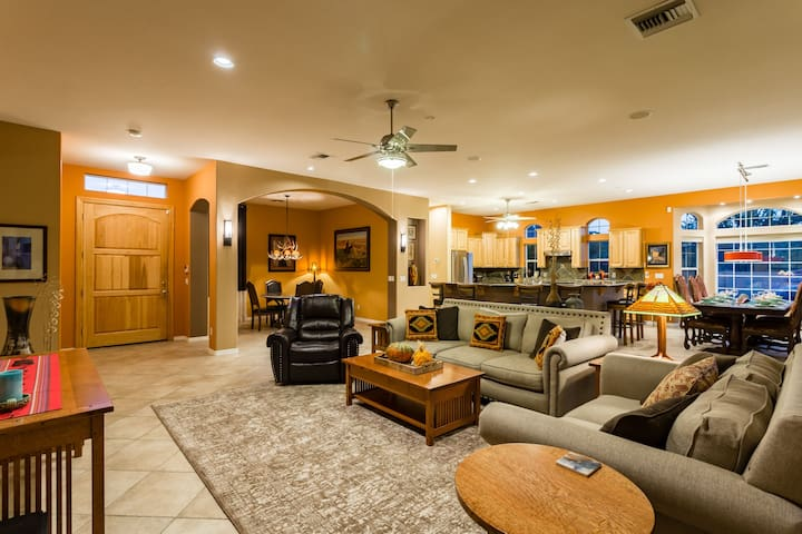 A Glance At The Living Room, Kitchen, and Formal Dining Room.