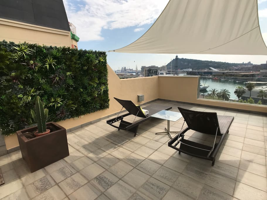 Private roof terrace, with sun loungers and outdoor shower