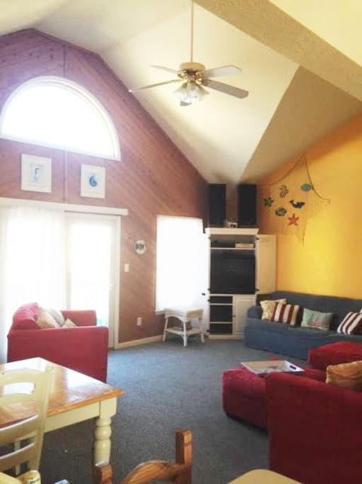 Family room with flat screen tv, blue ray player, and plenty of seating - open to dining and kitchen