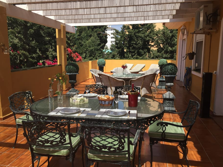 Terrace with dining table, lounge, sunbeds and bbq
