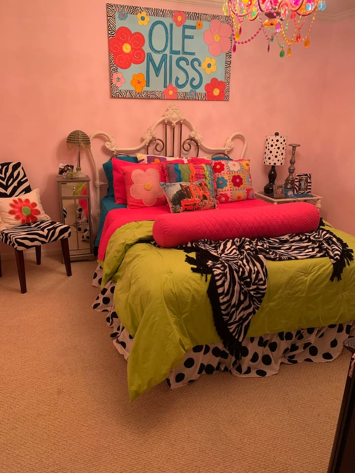 Queen size bed, this is a girly room.