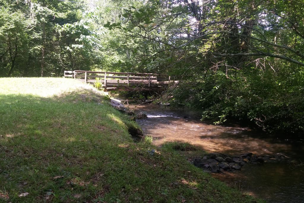 Yellow Creek, after a storm, and the bridge to the cottage.
