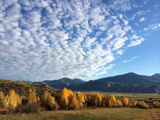 View looking east to Salt River Range in October from our wrap around deck.  The golden Aspen and Cottonwood trees line Anderson Creek on our property 80 acres.