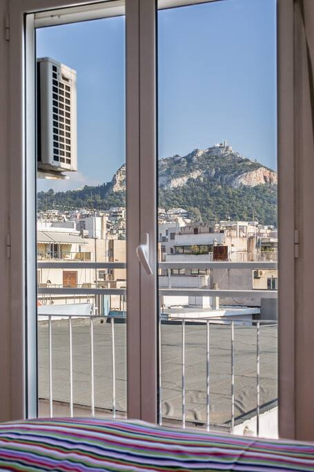 main room with a double bed and great view of the Lycabettus hill