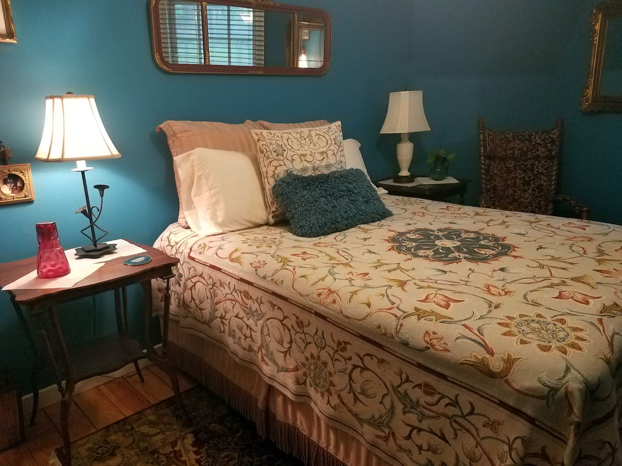 Superiorly comfortable queen bed in a softly lit room guarantee a good night's sleep!
