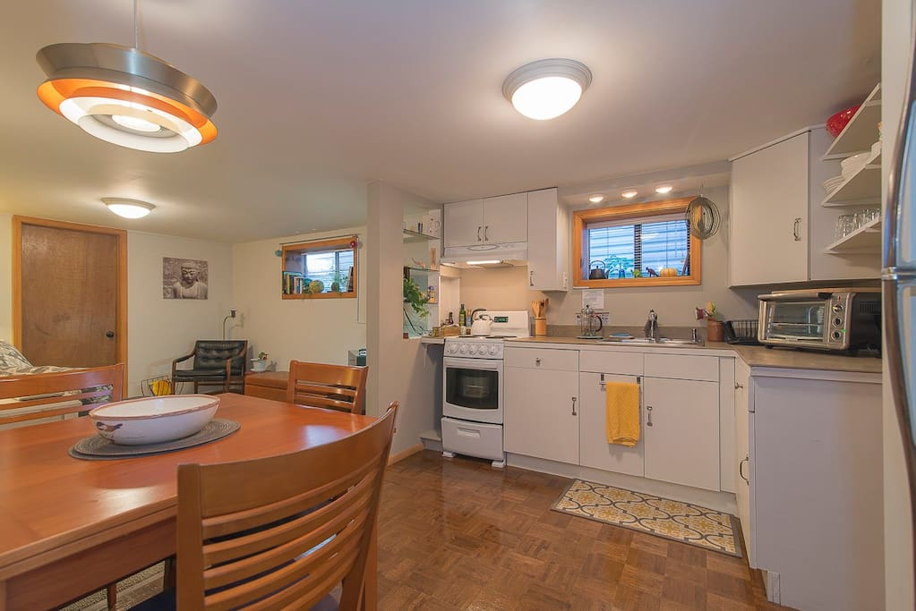 dining room table extends to seat 6, counter top convection oven to right side of photo.