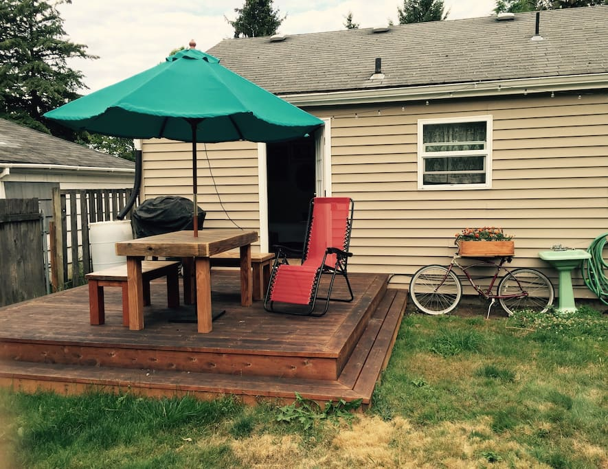 Deck, outdoor seating, gas grill.