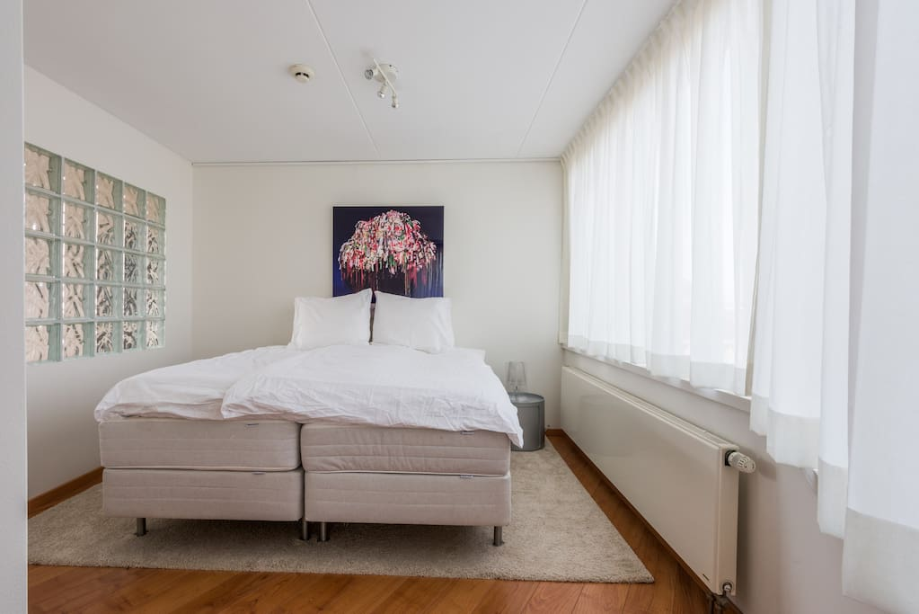 Light rooms and comfortable boxspring double bed. This room connects to the living room.