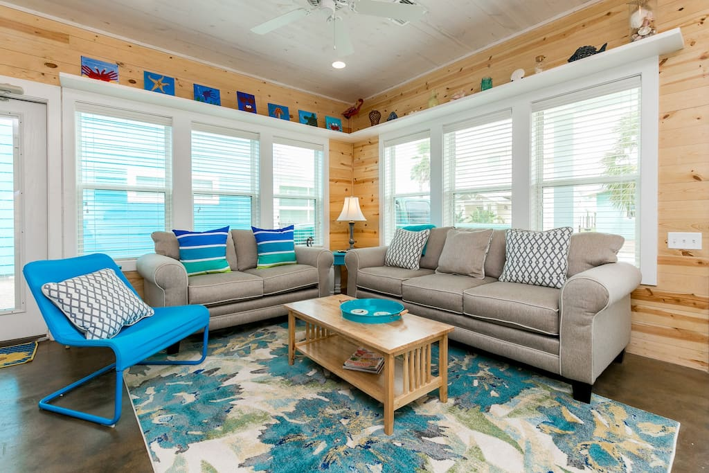 Beachy living space with lots of spots to sit and chat