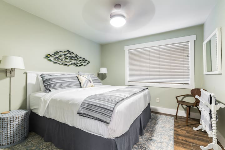 Front bedroom with King bed, pillow-top mattress, and luxury linens.