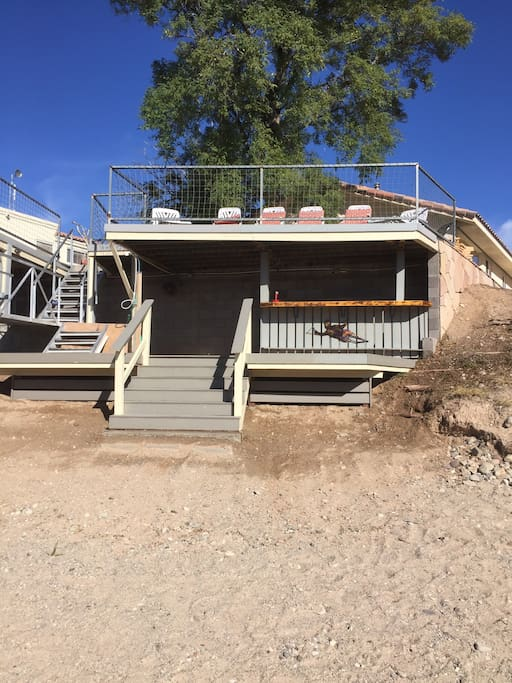 Upper and Lower deck/bar and approximately 50 foot wide beach.