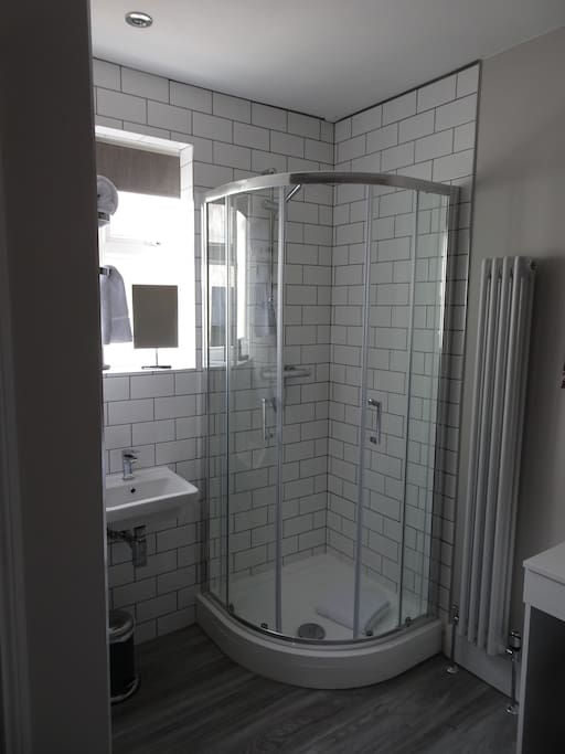 The shower and sink are part of you room, with your own private toilet housed in its own area.