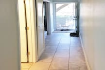 Wide-Angle view of entryway to this apartment. The front door allows cross breezes to flow through.
