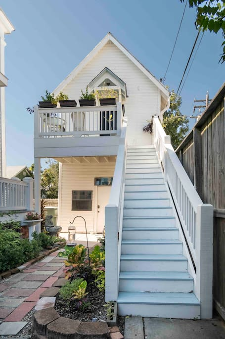 Carriage house has a private entrance and is accessed via the staircase shown in the photo.