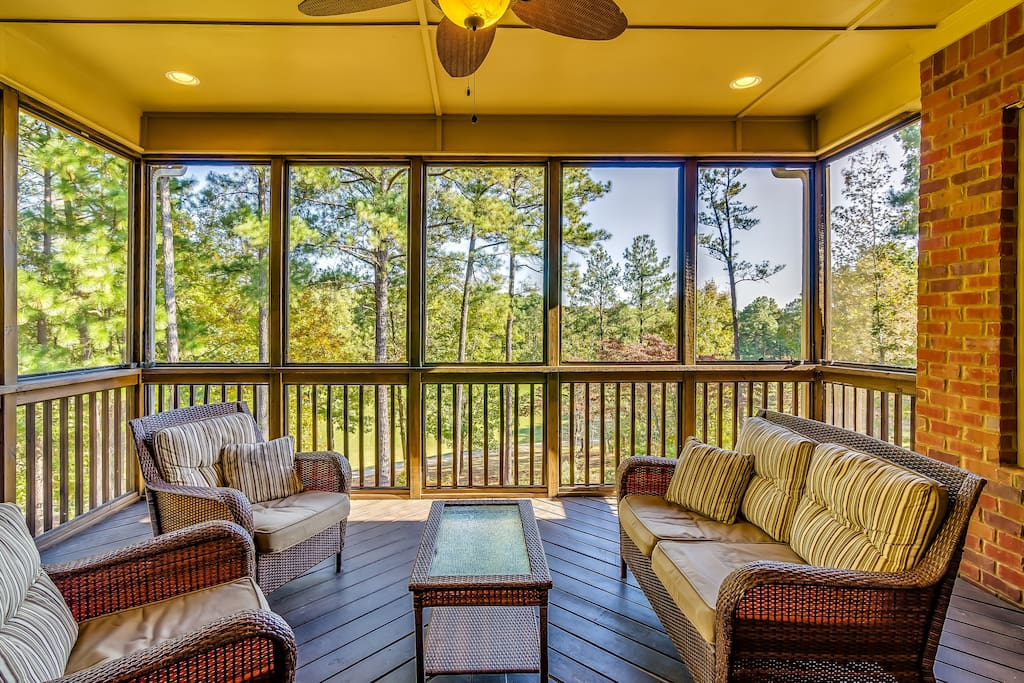 "Enjoy a glass of wine, a few beers or your morning coffee while relaxing on our ""tree-top"" screened porch."