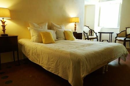 En-suite bedroom in large country house with pool