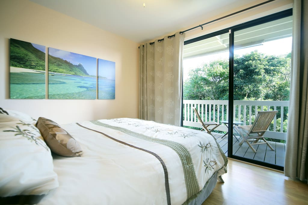King Bed overlooking private patio with jungle and Hanalei Ridgeline views!