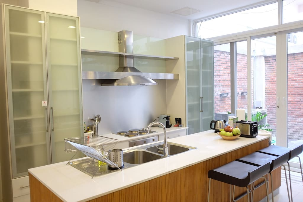Kitchen is equipped with modern appliances.