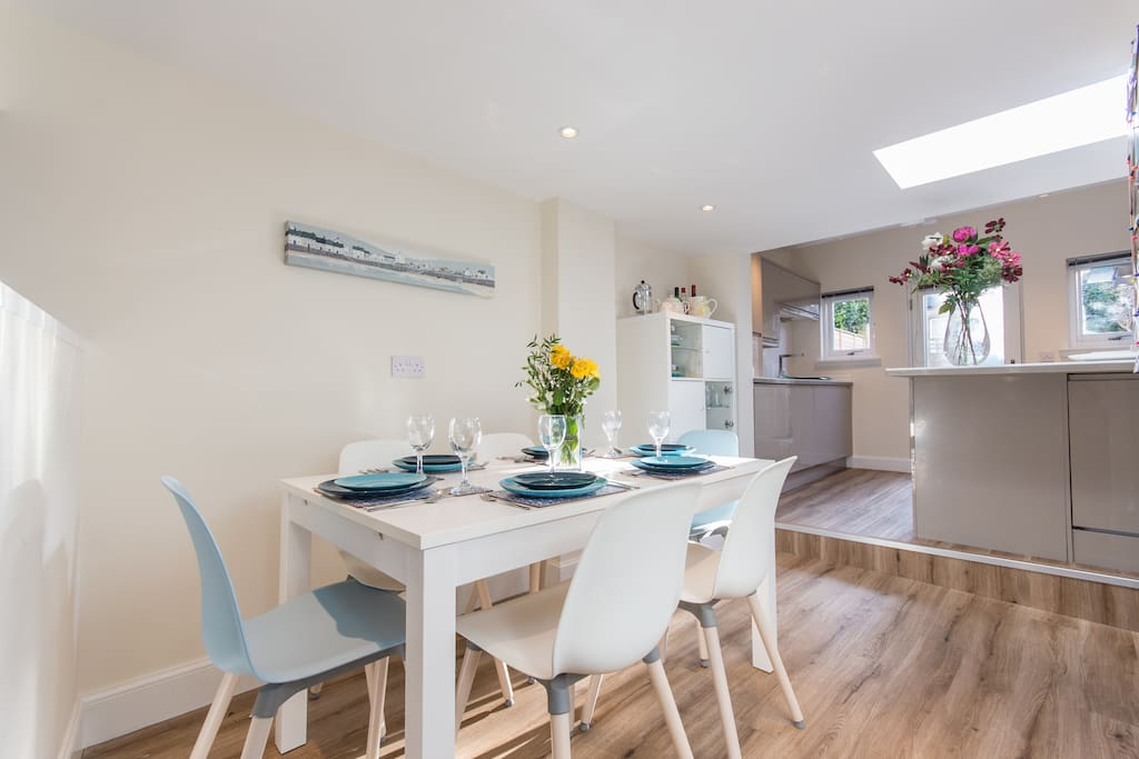 Bright dining area open plan to luxury fully fitted kitchen