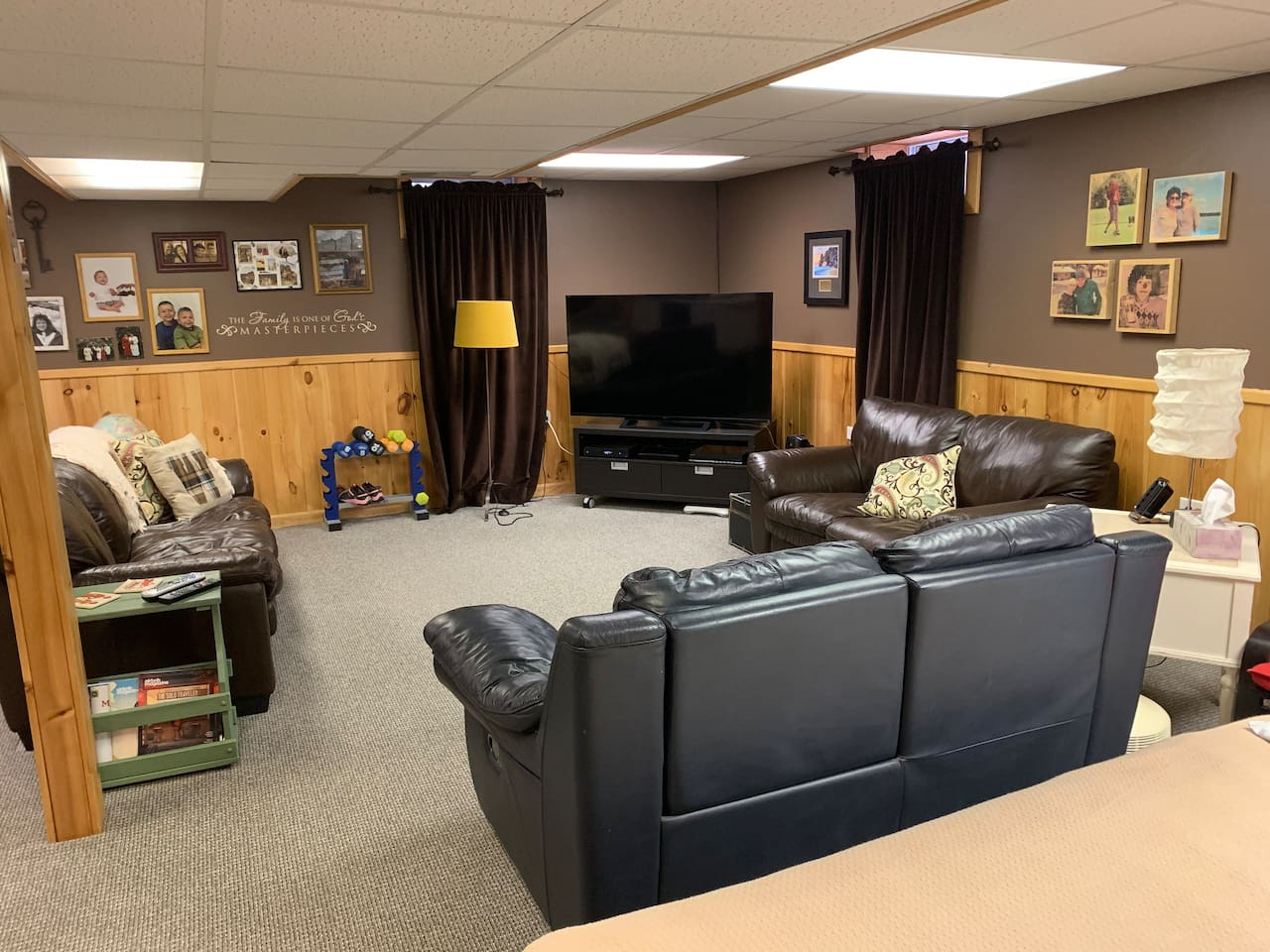 Spacious family room area with DVD, Blu-ray, and zillions of TV channels. Comfortable leather couches and recliners.