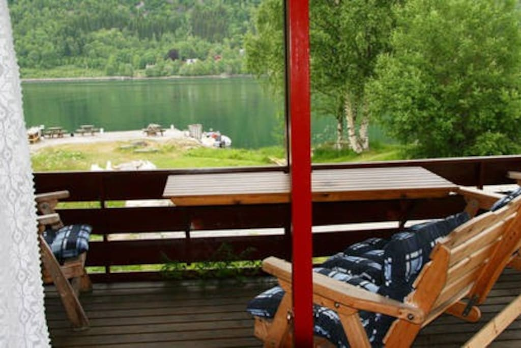 The cabin has a nice porch with furniture, where you can enjoy the view