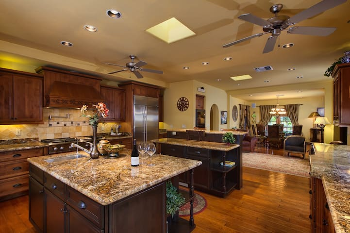 Upgraded kitchen with solid wood cabinets, granite counters, stainless steel appliances.