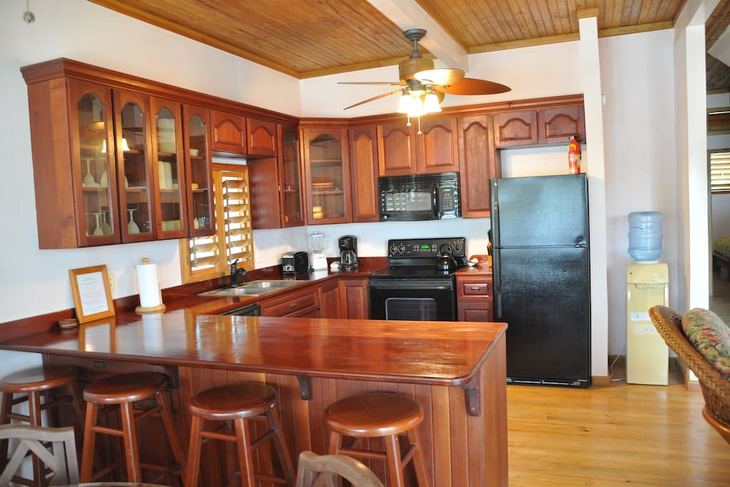 Kitchen with Custom Mahogany Cabinets and Counter Bar