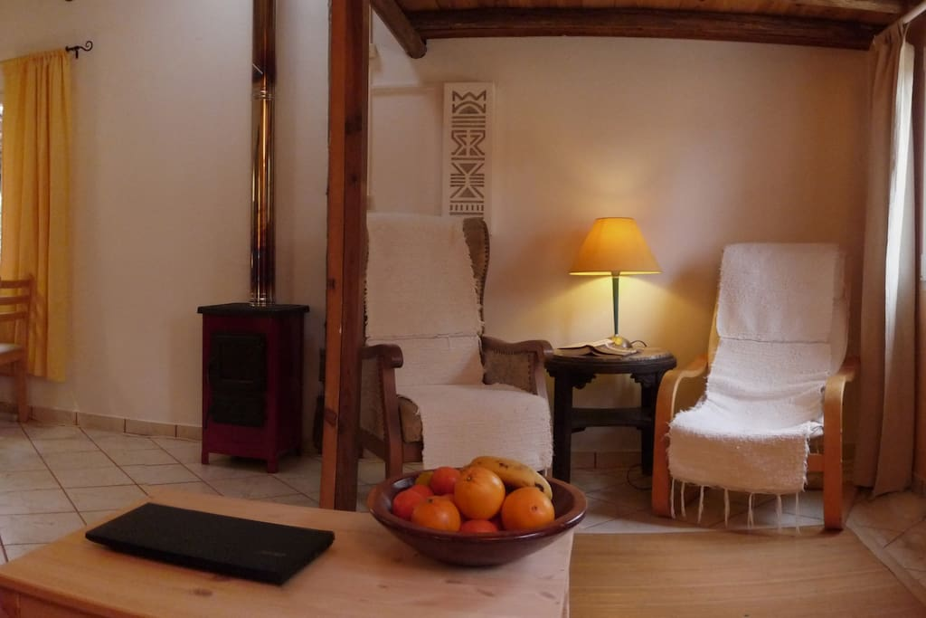 In the living room under the high bed, you can forget the time in this reading corner. During the winter time a wooden stove can easily heats the entire house if needed.