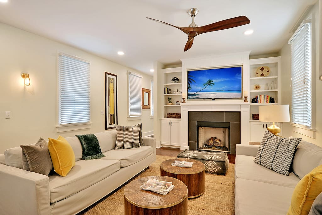 """Living Room (with Ceiling Fan, seating for 12, 65"""" 4K TV, and a gas fireplace)"""