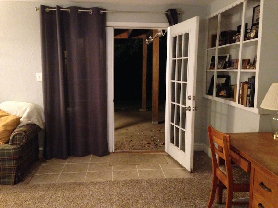 Private entrance, leads out to a large patio and swing.