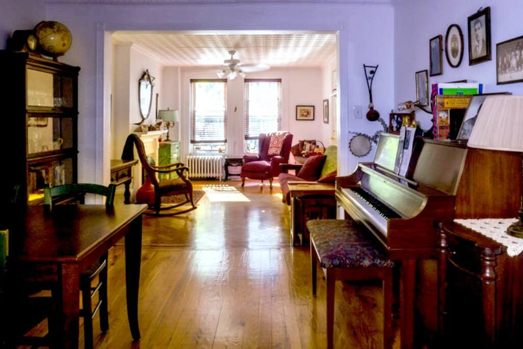 Living room and dining room with piano