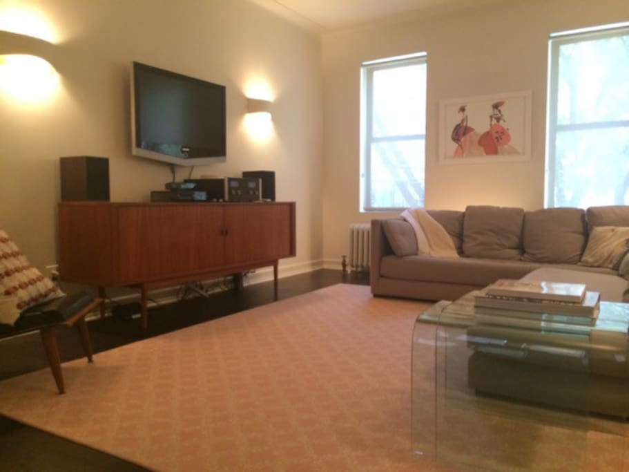 The large living room with big, comfy couches, is located adjacent to dining room