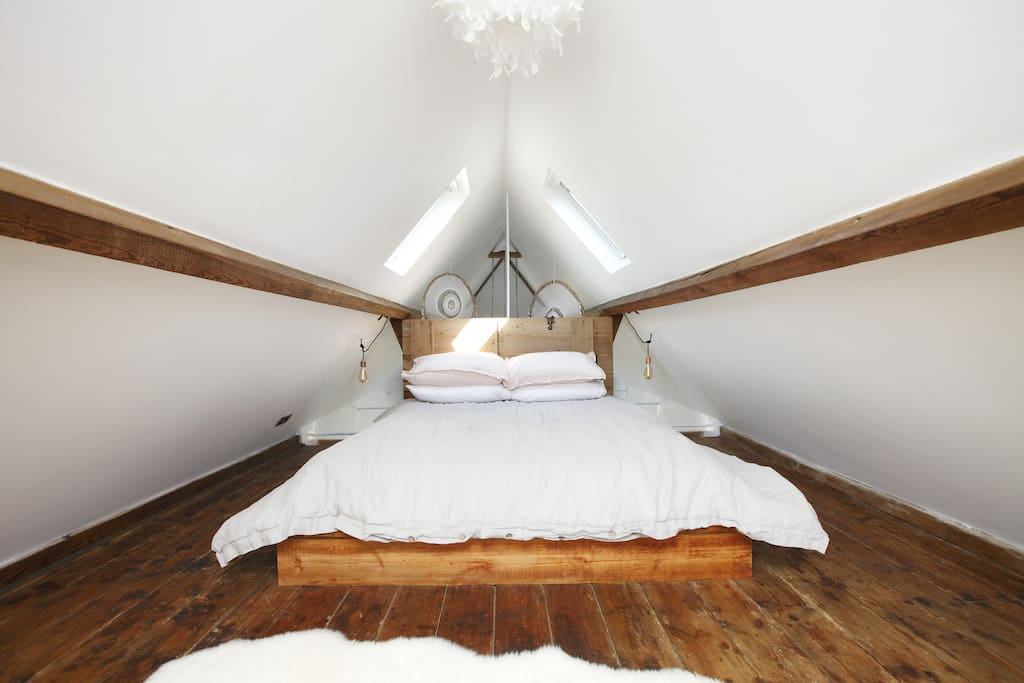 Up the original hayloft ladder to your king sized bed