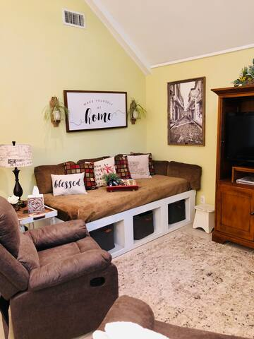 This sofa/daybed has an xl twin mattress available for guests.  The pillows, linens and comforter are available in the bins below the bed.   We will be happy to have it made up and ready for you if you need it.