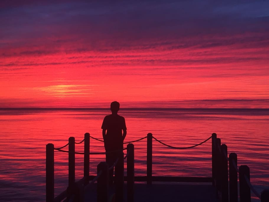 Young teen amazed by sunset.