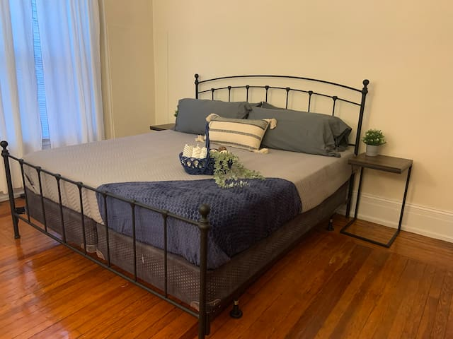 Comfy bedroom with king bed and original hardwood floors