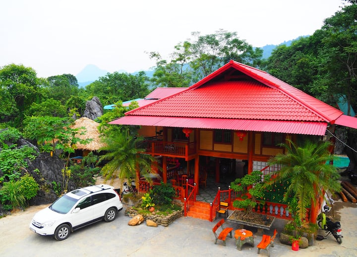 Bungalow dormitory with 3 doublebeds at RockGarden