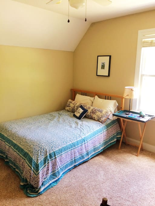 Comfy double bed in the light-filled eves of the house