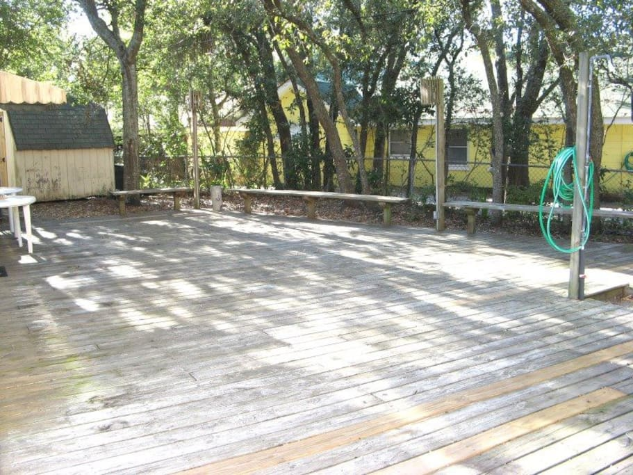 Enjoy the Tybee breezes and sounds of the ocean on the large decked backyard that features a beach shower