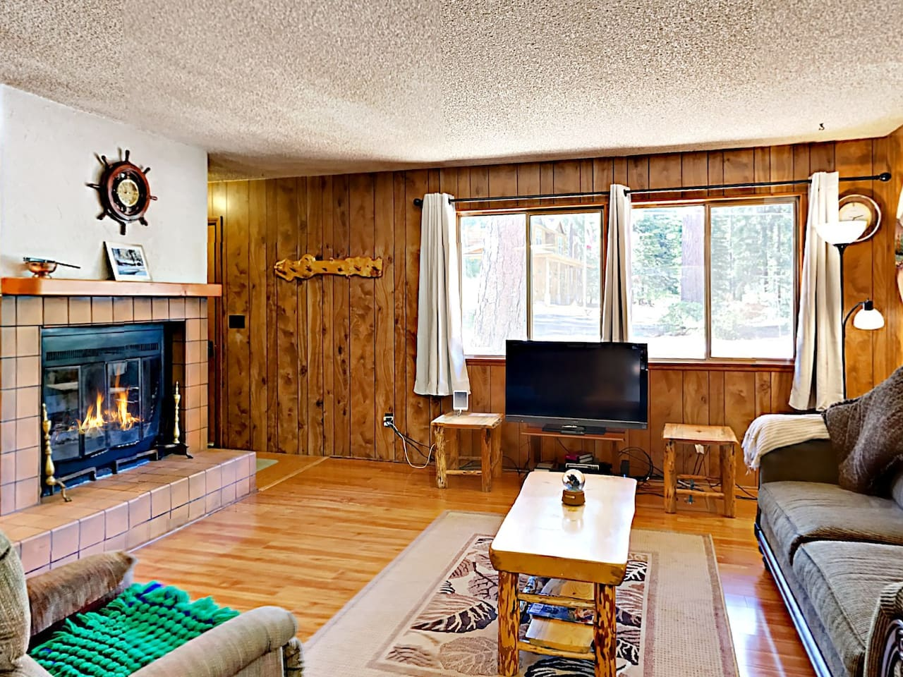 Welcome to Tahoe City! Gather around the fireplace and enjoy a movie night on the flat screen TV.
