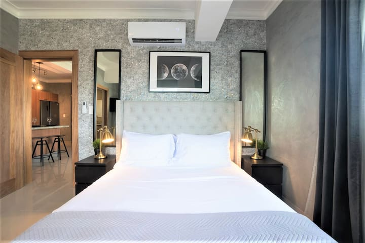 The Luxurious Spacious Bedroom Comes with a Top-Brand Queen Size Bed, Private Ensuite Bathroom with Rain Shower, Spacious Walk-in Closet, Desk, AC, FAN, 42 inch Smart TV + Cable, Movies etc, Fast WIFI and City Views.