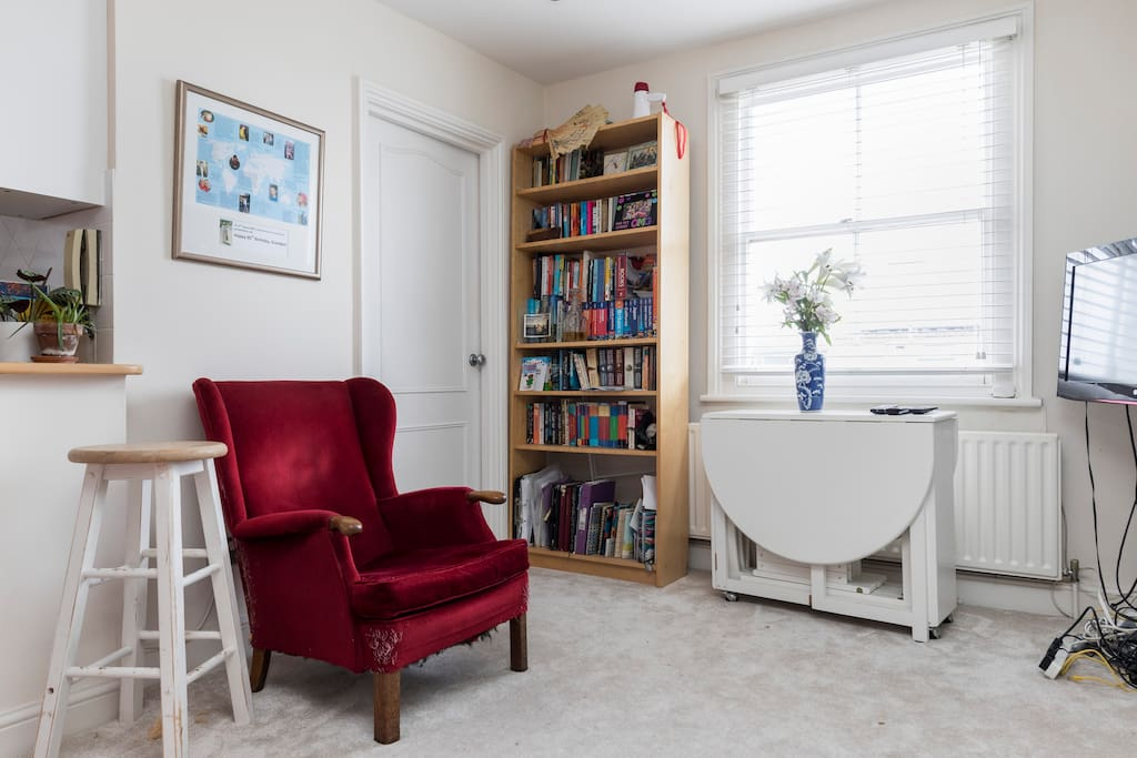 TV, DVD player and wifi. The white side table converts into a table and chairs for 4 people. Board games and books for people fancying a quiet night in.