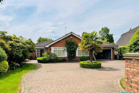 Large attractive bungalow in Hale Barns