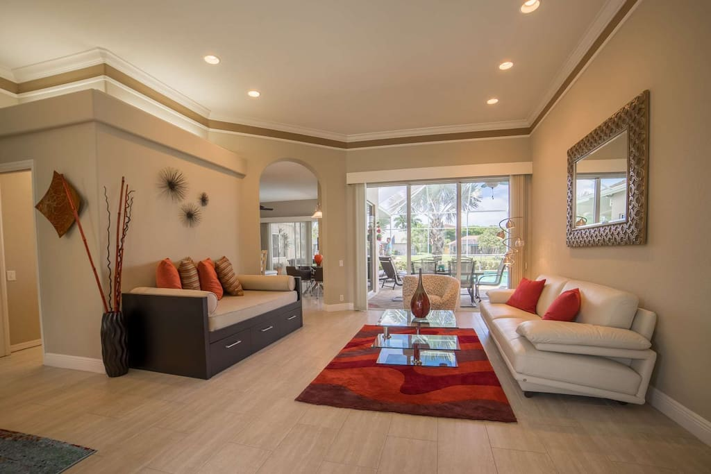 Welcome to the lap of Florida luxury! Formal living room opens to the screened lanai and canal beyond.