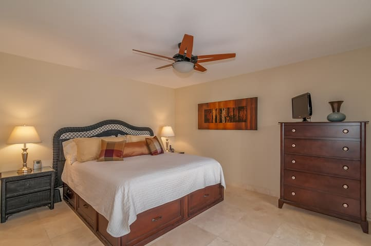 King size, comfortable master bed; note TV on dresser