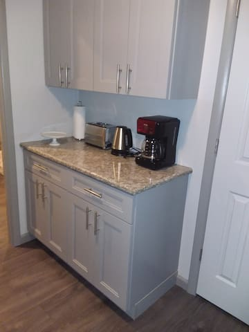 Coffee maker, toaster, and water kettle in kitchen