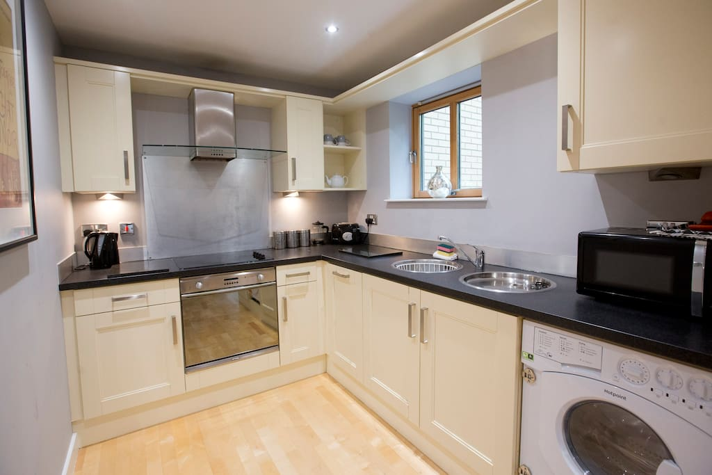 The fully-equiped kitchen is just off the main lounge