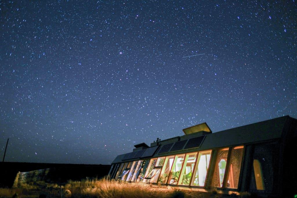 Earthship blanked under crystal clear starry skies.