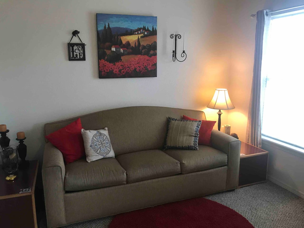 Living area with a sleeper sofa that is queen size. TV with local channels and Amazon Firestick channels.