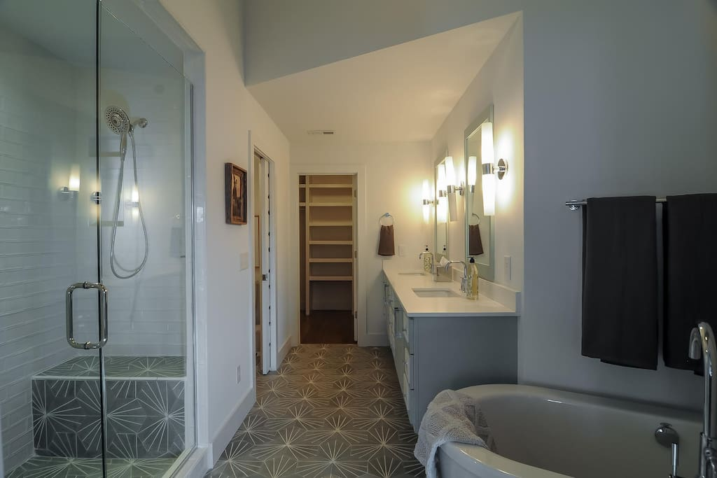Gorgeous master bathroom with soaking tub, huge stand up shower, and double vanity.